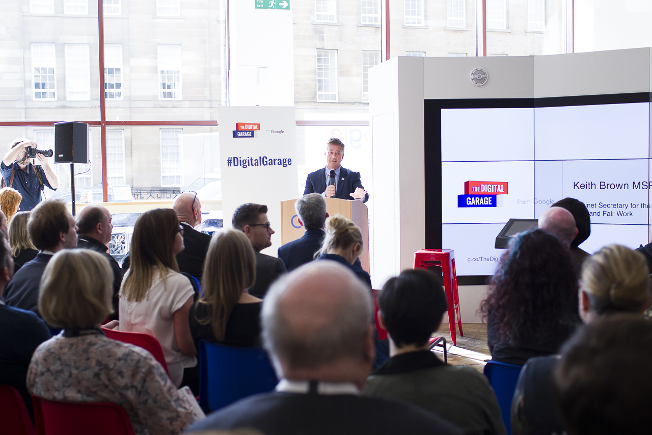 Keith Brown, M.S.P, speaking on a podium at the Google Digital Garage launch event in Glasgow