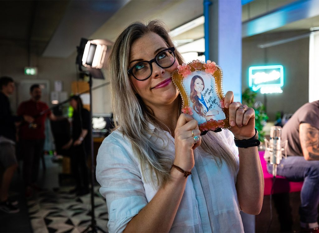 Emma with photo of dr Sandra Lee
