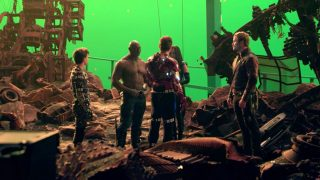 Actors standing On the Set of Avengers: Infinity War with green screen in the background