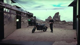 Man standing next to motorcycle on virtual production set