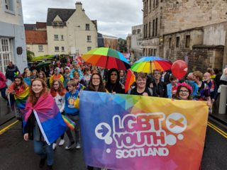 photo of 100 kids marching for LGBT Youth Scotland at Pride Edinburgh 2019