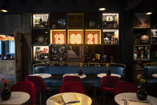 Photo of interior wall of DOppio Malto restaurant with the opening date on a neon sign MadeBrave creative PR launch campaign