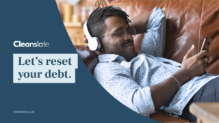 Cleanslate Design with man laying on a couch relaxing with his phone. Tagline says